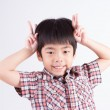 Child Making Peace Sign — Stock Photo #34626233