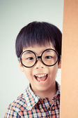 Cute asian boy wear glasses (retro filter) — Stock Photo