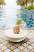 Bromeliad in glass decoration swimming pool — Stock Photo