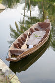 Wooden boat on water — Stock Photo