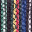 Image of braided multi colored woollen yarns — Stock Photo