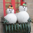 Snowman in a hat standing outside the window — Stock Photo #45921257