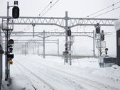 Many snowy railroad tracks in hazy winter — Stock Photo