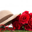 Red roses and glasses on green grass — Stock Photo #46248957