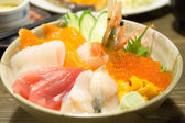 Various kinds of sashimi raw fish rice bowl in Japan (selective  — Stock Photo