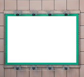Green blank billboard with spotlight for your text or picture — Stock Photo
