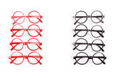 Stack of red and black glasses isolated on white — Stock Photo