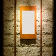 Blank wooden frame on stone wall illuminated spotlights in inter — Stock Photo #46882537