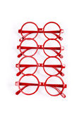Stack of red glasses isolated on white — Foto de Stock