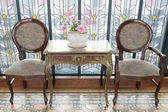 Classic antique table and chairs — Stock Photo