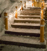 Wooden stair lighting in christmas with snow covered — Foto Stock