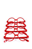 Stack of red glasses isolated on white — Stock Photo