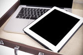 Modern white tablet pc in briefcase isolated on white (vignette  — Stock Photo