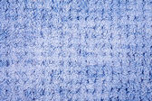 Blue wool knitting pattern close up — Stock Photo