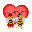 A couple of funny cartoon bees with a red heart — Stock Vector