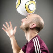 Soccer Player Balancing Ball on Head — Stock Photo