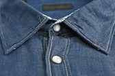 Collar of denim shirt and two buttons in focus — Stock Photo