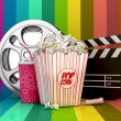 3D Colorful Cinema concept-pop corn,film reel,clapper board,drink and ticket object — Stock Photo