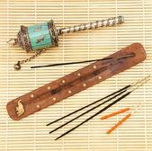 Oriental incense and manual Buddhist Stupka — Stock Photo