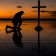 Kneeling Before The Cross — Stock Photo #26504477