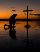 Kneeling Before The Cross — Stock Photo