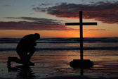 Man Kneeling Cross — Stock Photo