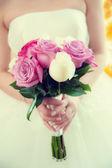 Bride holding weeding bouquet — Stock Photo