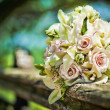 Beautiful bouquet on the wooden handrail — Stock Photo