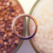 Wedding ring on the grains — ストック写真