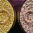 Wedding rings in the grains — Stock Photo