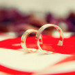 Wedding rings with  ribbon — Stock Photo