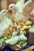 Wedding rings with wedding doves in the background — Photo