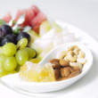 platter of assorted fruit and nuts — Stock Photo
