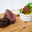 Beef meat slice served with vegetables — Stock Photo