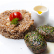 Meat cutlet with buckwheat porridge decorated cherry tomato — Stock Photo