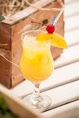 Cocktail orange maraschino cherry and mango — Stock Photo