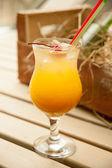 Cocktail with orange Juice, cherry decoration — Zdjęcie stockowe