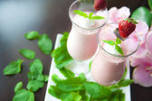 Strawberry yogurt with cream and mint — Stock Photo