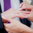 Newlyweds exchanging wedding rings — Stock Photo