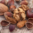 Stock Photo: Walnuts, chestnuts, hazelnuts and almonds