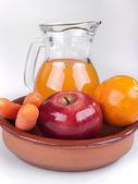 Apple, orange and carrots — Stock Photo