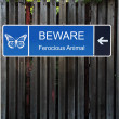 Beware Horizontal Blue Sign on Old Wood Fence — Stock Photo