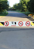 Road Gate with Danger and Interdiction Signs — Stock Photo