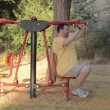 Stock Video: Fat mon pull down trainer