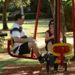 Seated pedal machine in the fitness park — Stock Video