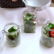 Stock Video: Filling veggies jar with fresh brine solution
