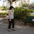 Stock Video: Woman cleans the litter left by someone
