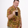 Pint of dark beer in the hands of a smiling fat man — Stockfoto