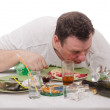 Mwoke up still drunk on dirty table — Stock Photo #30689587