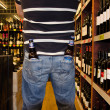 Foto de Stock  : Two Bottles Samuel Adams in two pockets